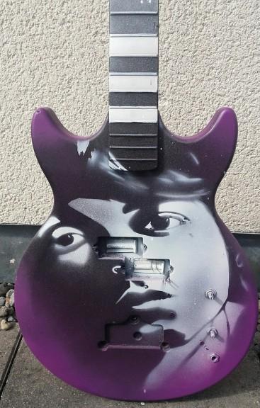 Paul McCartney Face on a Bass by Ray Mullan