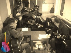 Musical Youth Foundation - Teaching guitar at St Andrews b&w